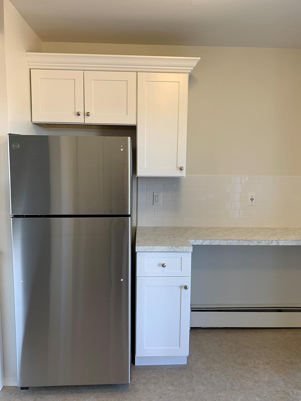 Kitchen refrigerator in Brookwood apartment